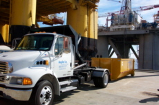 Easy-Haul Roll-Off Waste Container and Truck, Waste Hauling Service at Oil Rig